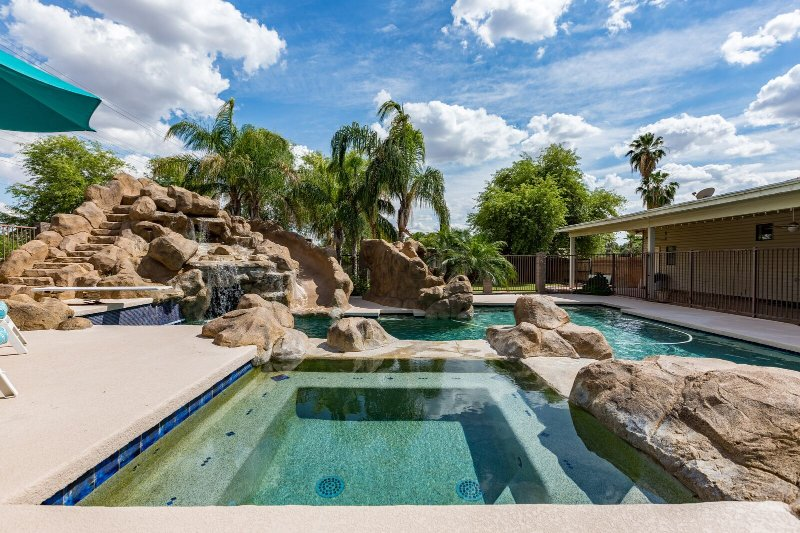 Backyard Oasis with a waterslide and Hot Tub!