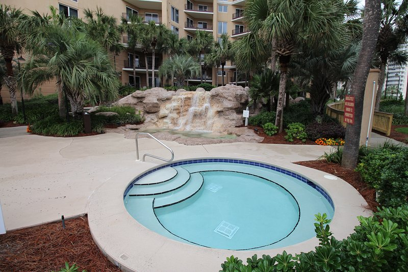 Hot tub area with waterfall