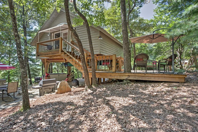The treehouse-type home features a patio where you can relax in the outdoors.