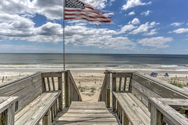 Let your worries float away as you relax in this 4-bedroom, 2-bath vacation rental house right on the shores of Oak Island.