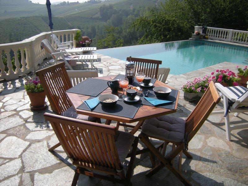 Take your breakfast by the pool over looking the vinyards