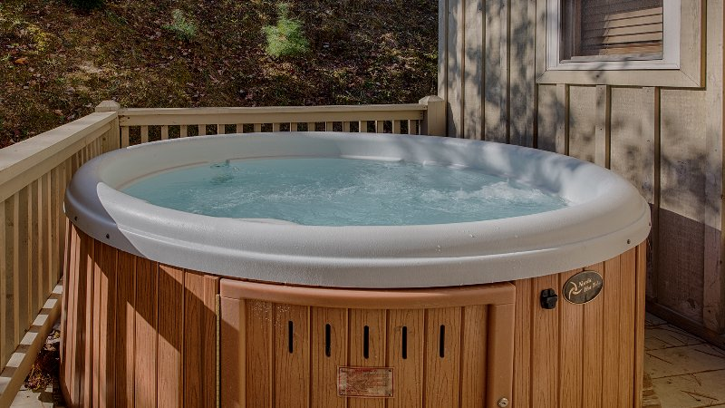 Hot tub located on side deck of cabin - just off one of the bedrooms.