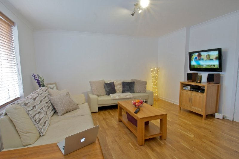 Open plan lounge - with music amplifier, freeview TV channels, DVDs, books to enjoy during your stay