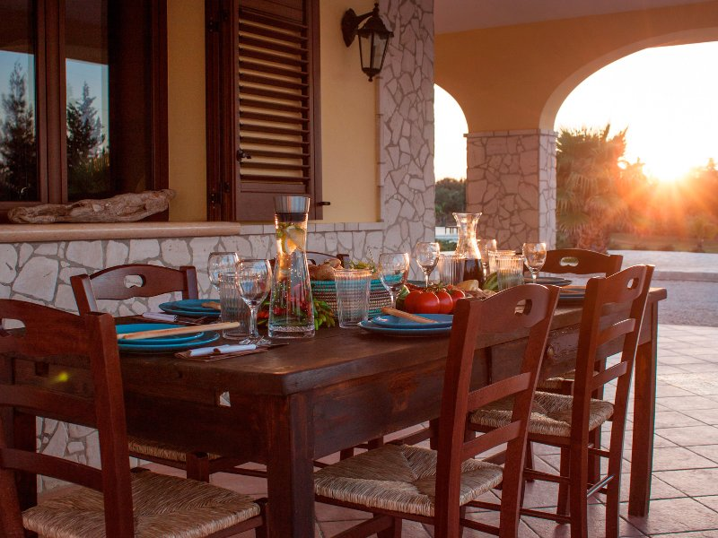 A large table for a cozy dinner on the terrace.