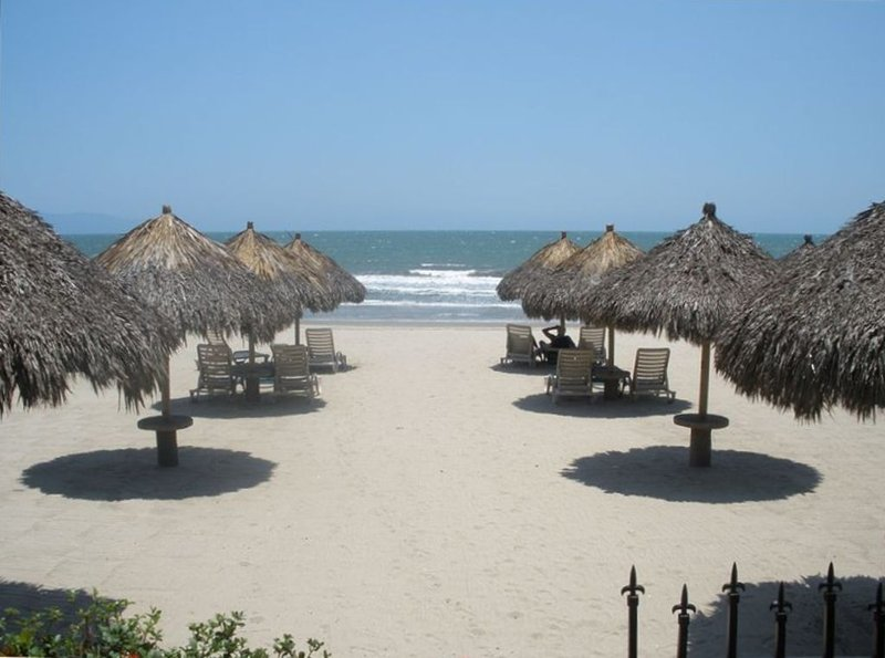Beautiful miles of beach at your complex with beach loungers and palapas