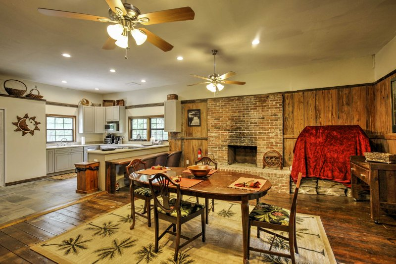 Wine and dine in the spacious dining area, complete with a decorative brick fireplace.