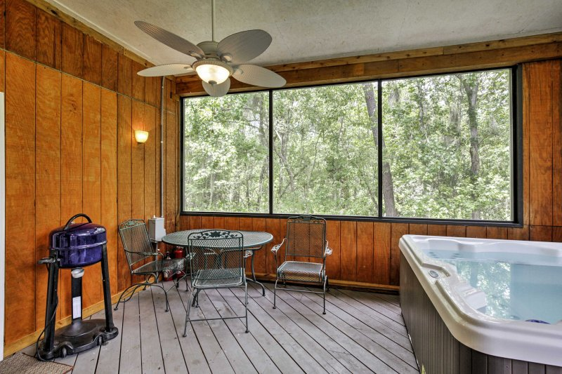 Sip your favorite beverage on the screened-in porch.