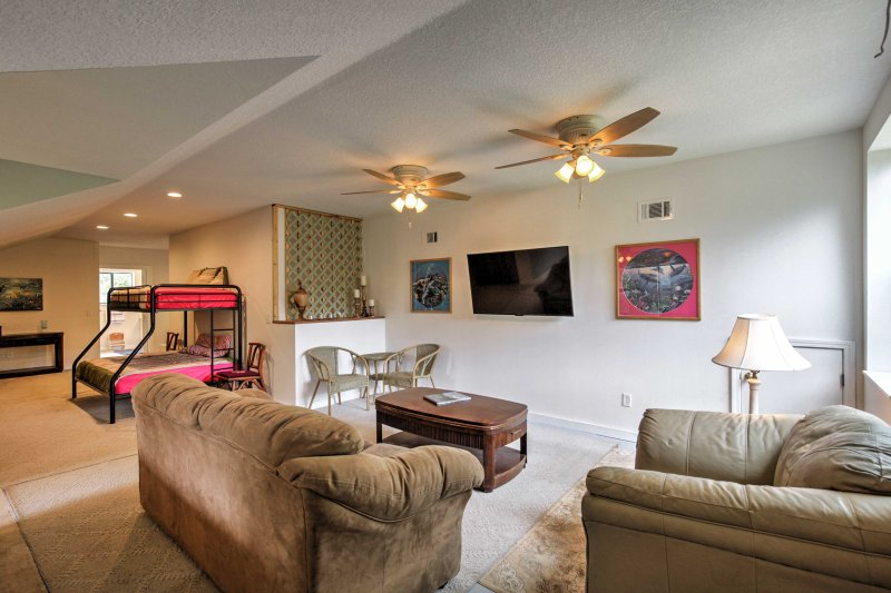The loft offers a sitting area with comfortable furniture and a TV with Roku streaming.
