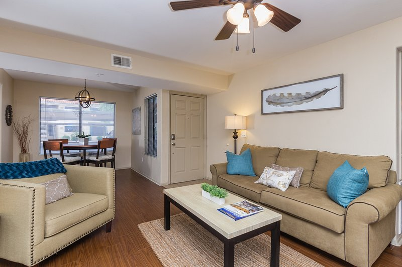 Beautiful, contemporary decor in this centrally located ground floor condo