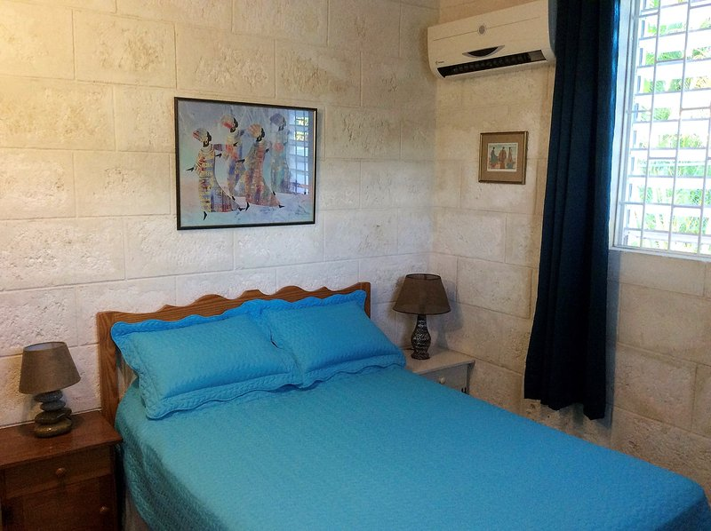 #3 Bedroom has a Full Bed, Dbl Closet, A/C and Ceiling Fan 2 windows provide a lovely cross breeze.
