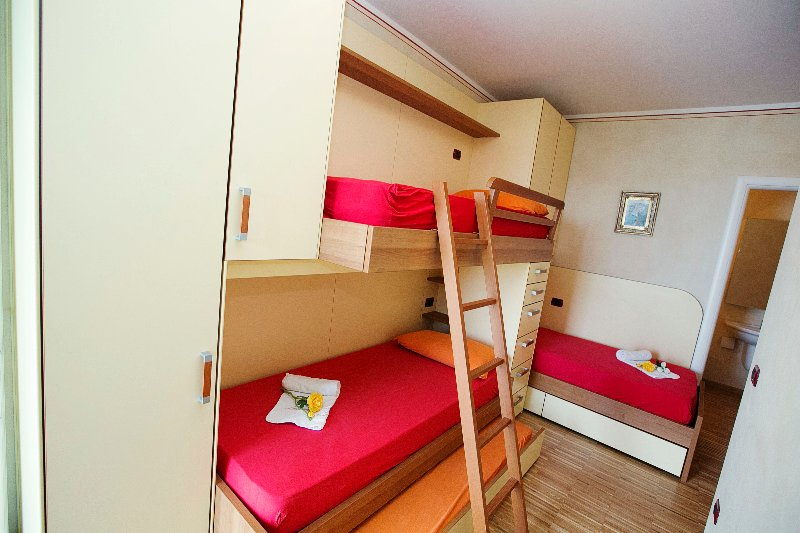 Bunk-Bed with ladder, wardrobe and slide-out bed.