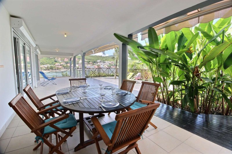 Long dining table on the terrace with sea view