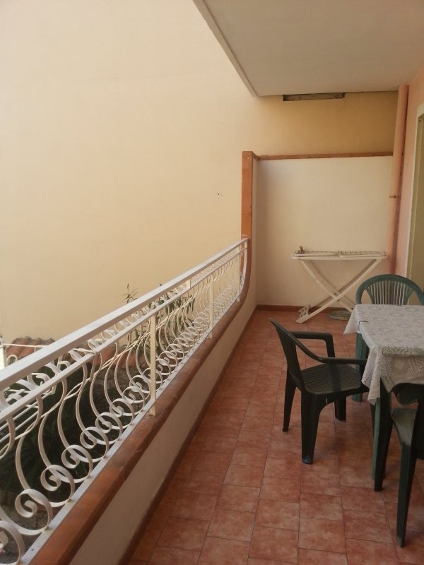 section of the balcony with table and chairs.