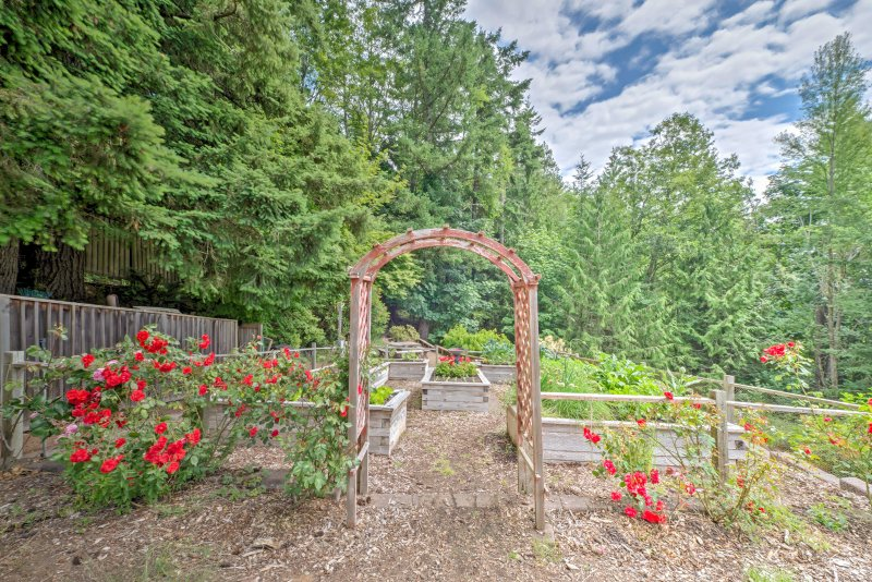 You'll love the veggie garden and beautiful flower beds on this lush property.