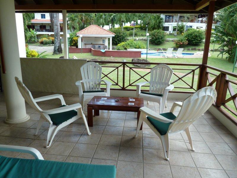 Verandah with seating area overlooking main pool