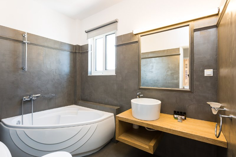Family bathroom with bathtub.