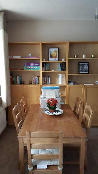 Dining for 4 people plus plenty of books/DVDs & games