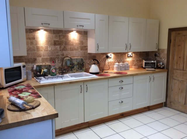 Bespoke fitted kitchen fully equipped for guests needs