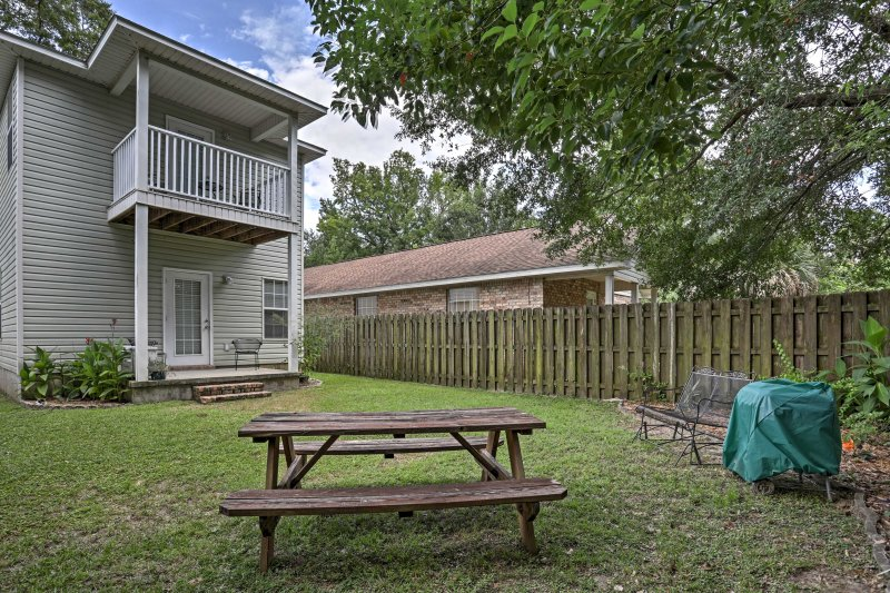 Relax in the backyard while staying at this lovely Pensacola home.