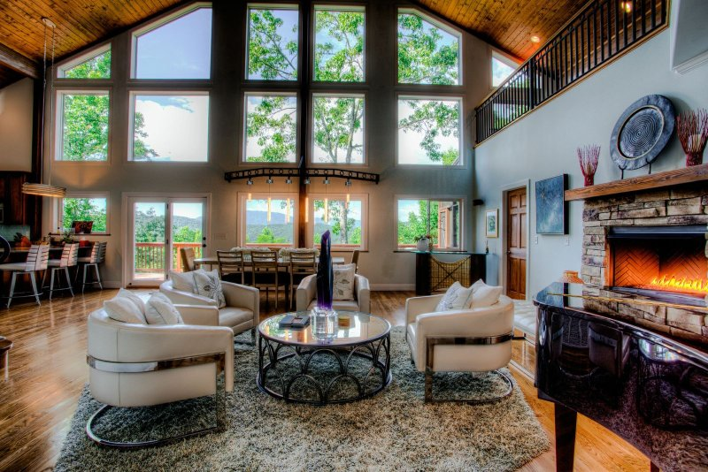 The Whispering Stream Great Room with the gas fire place adding warmth and ambiance and views of the Blue Ridge Mountains on the horizon.