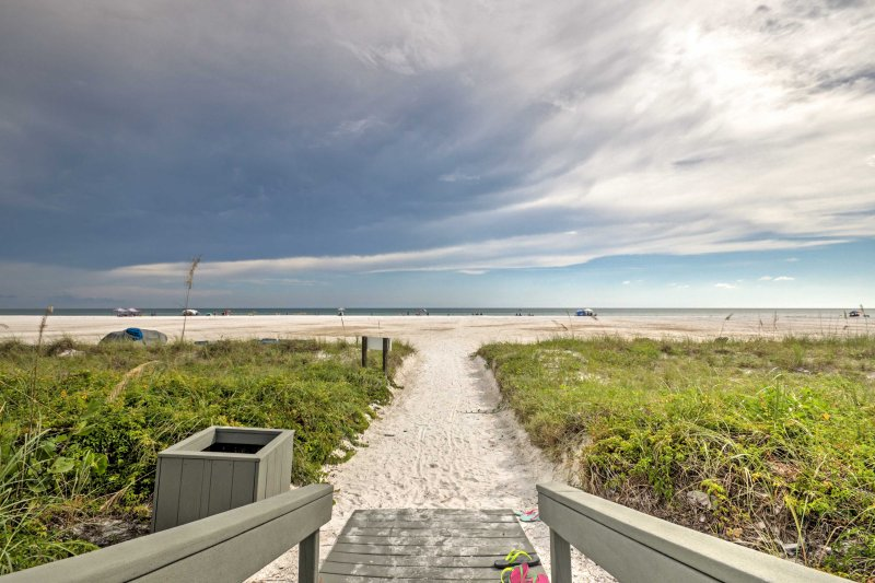 The 2-bedroom, 2-bathroom condo sleeps 6 guests just steps from the beach!