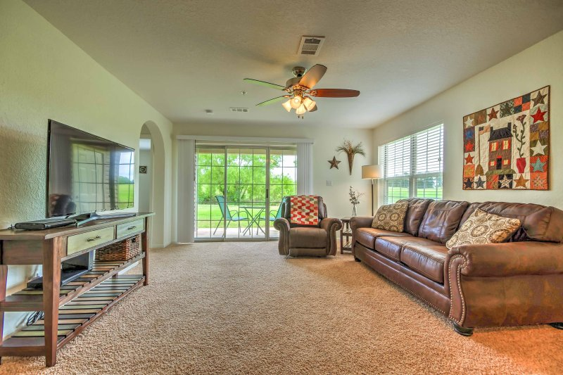 Unwind in the living room which features a sumptuous leather couch, a recliner, and a flat-screen cable TV.