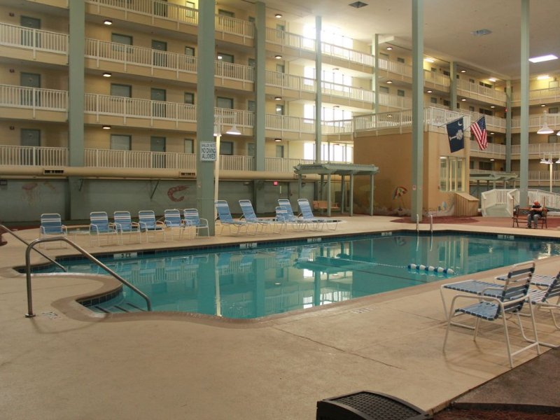 The indoor pool steps away in the opposite direction 0f one of the  outdoor pools.
