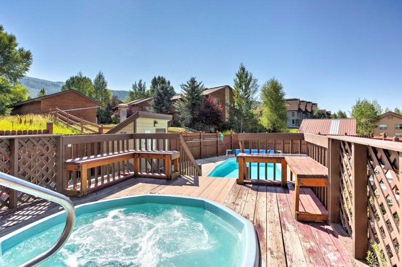 Relax in the community hot tub at night and enjoy the sunset during your stay at this 2-bedroom, 2-bathroom vacation rental condo in Steamboat Springs!