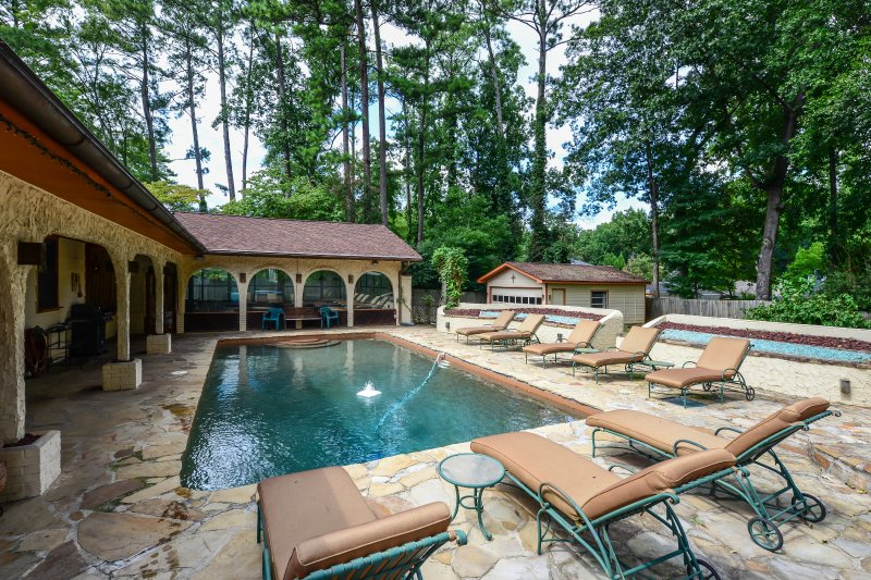 Backyard Oasis - pebble tech pool, hot tub, custom fire pits, cabana, large private fenced in yard