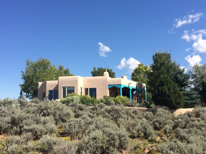 House sits a large piece of property bordering empty Pueblo lands.