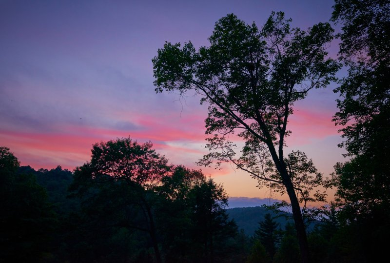 A typical mountain sunset view from the Spring Lodge front porch.