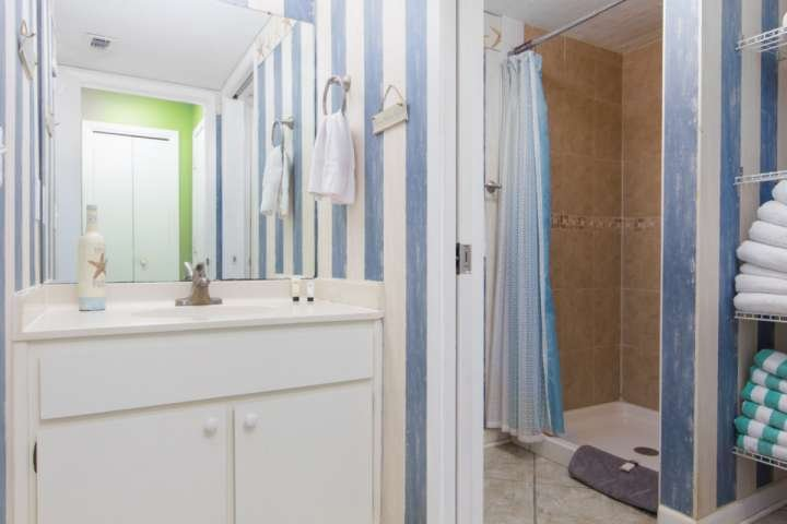 One of three full bathrooms located on the first floor