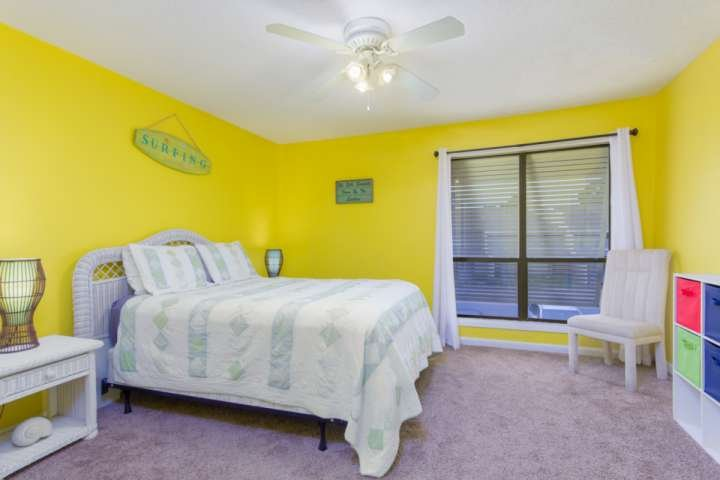 Large and bright second bedroom with a queen bed
