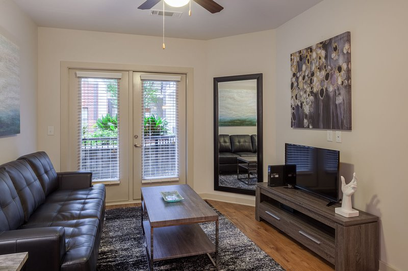 Stay Alfred on Ponce De Leon Avenue Living Room. Perfect for a movie night.