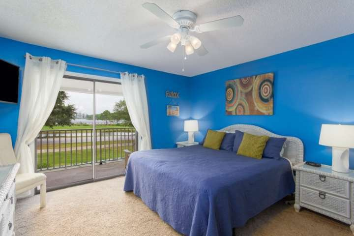 Large master bedroom with beautiful views of the lake and bay