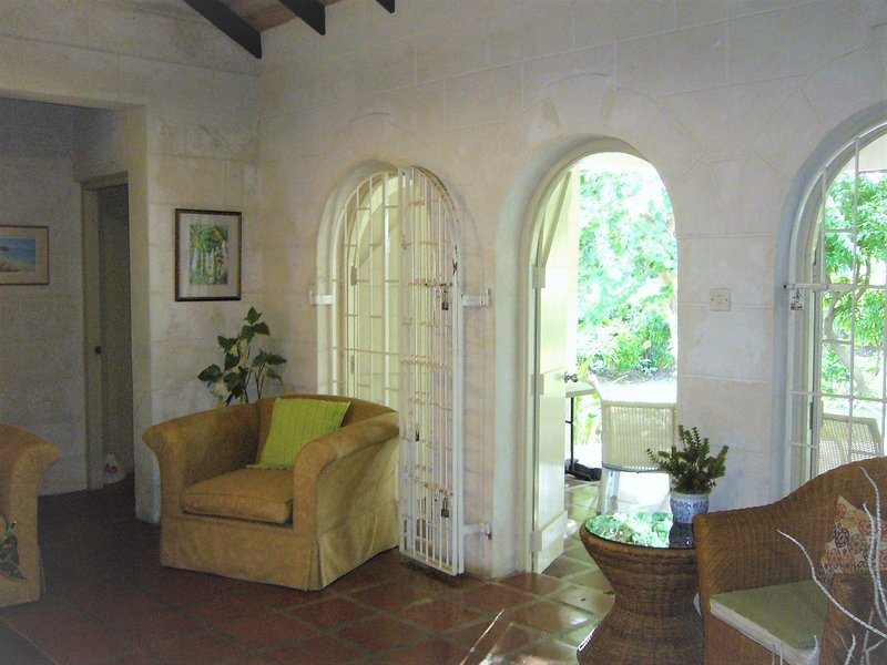 Living Room, to Veranda - open door to let in the cooling breezes.  High efficiency ceiling fan, too