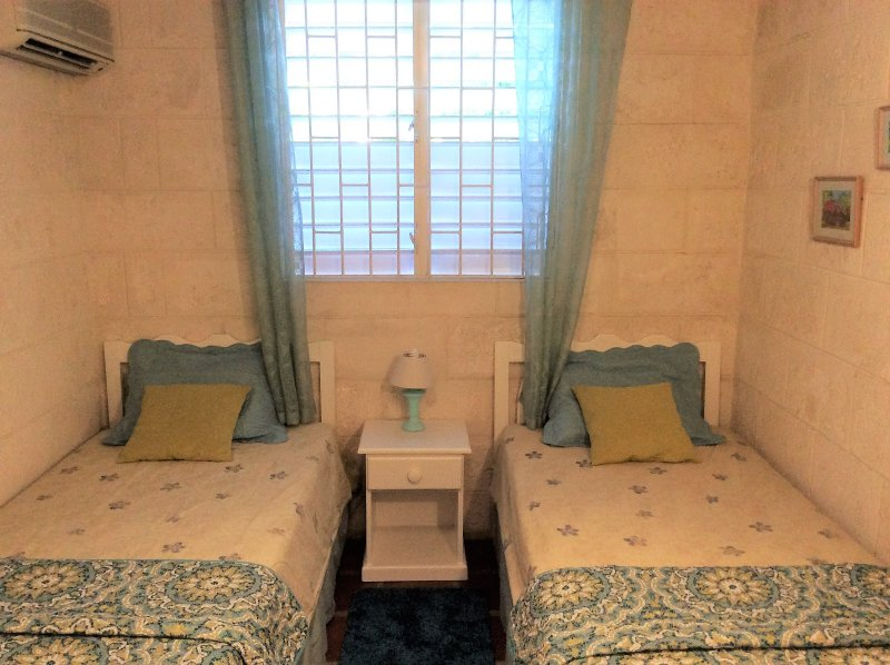 Bedroom 2 - single beds can be put together to form a king sized bed for couples.