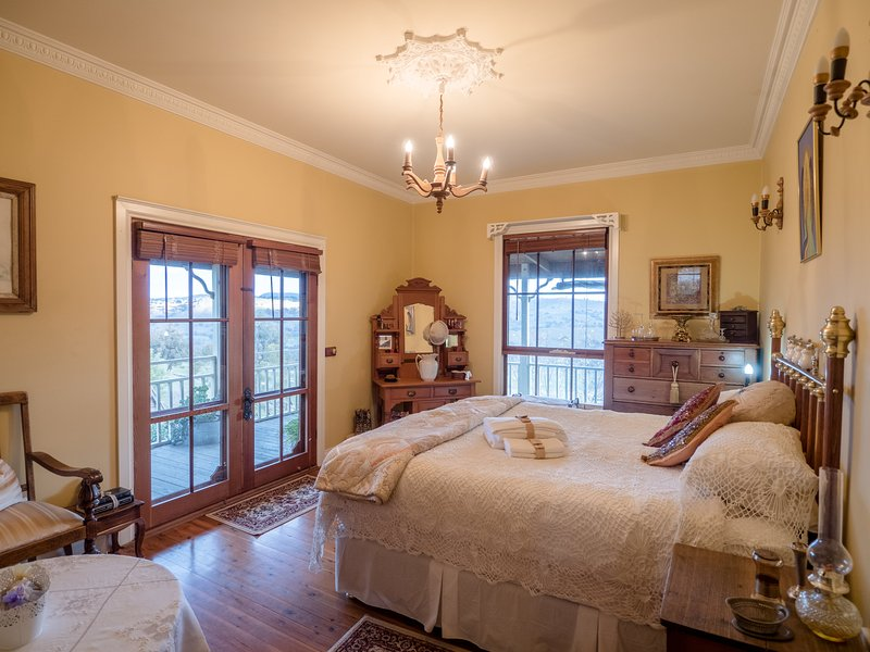 Romantic Suite. King bed, big picture windows with views, indoor and outdoor dining with kitchenette