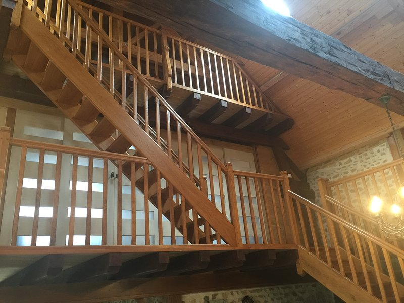 Stunning oak staircase up to bedrooms and mezzanine