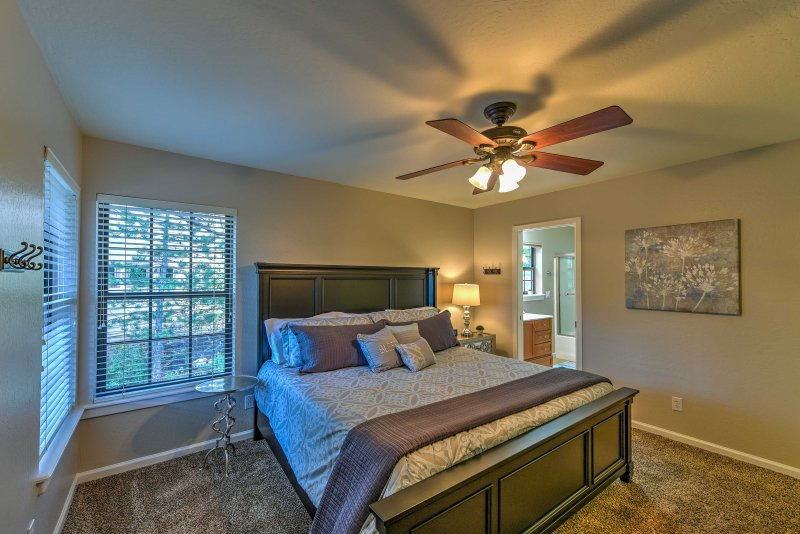 This second master bedroom features a king bed, flat-screen Smart TV and full en-suite bathroom.