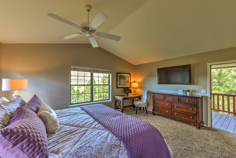 The master suite boasts private access to the deck, along with a king bed and flat-screen Smart TV.