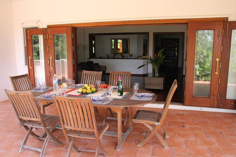 Covered dining patio next to the living room and kitchen. Ideal for al fresco dining.