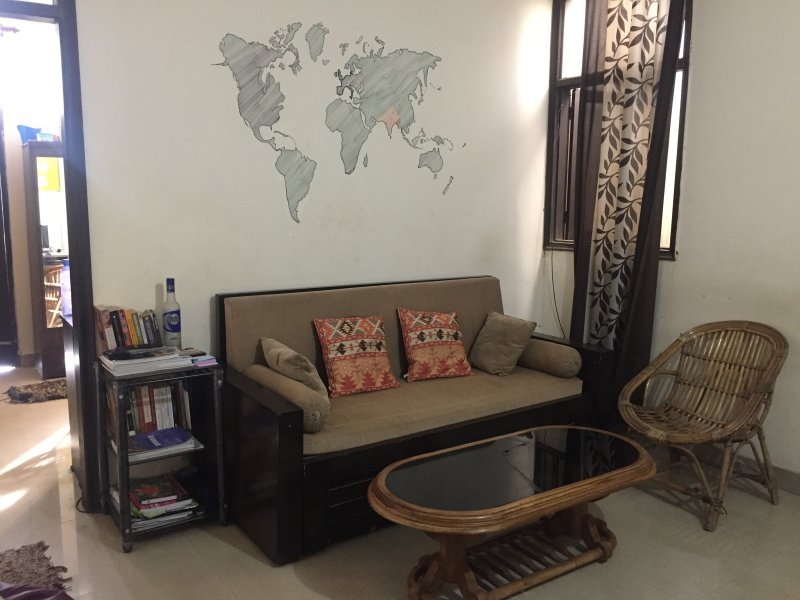A.C. living room with queen-size sofa bed, television and refrigerator.Ready to accommodate 2 person