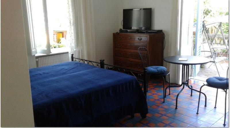 slaapkamer met directe toegang tot de tuin