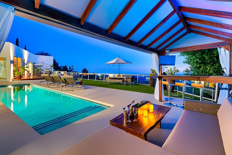 Backyard terrace with pool and views