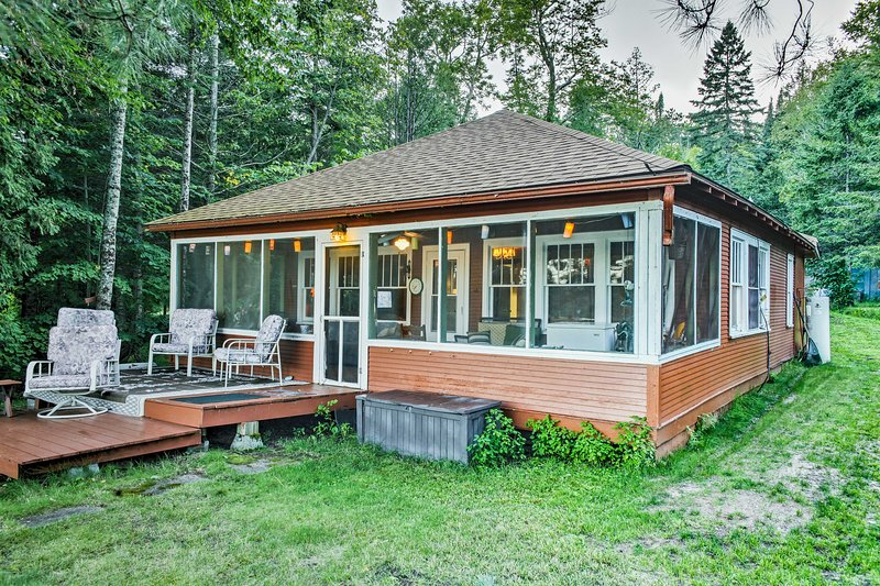Gather your family for a relaxing lake retreat at this 3-bedroom, 1-bathroom Solon Springs vacation rental cabin!