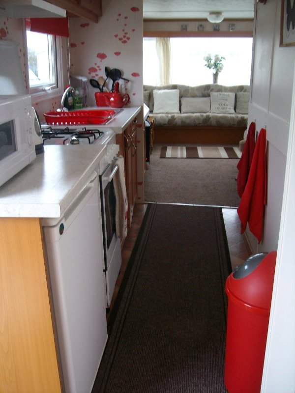 Galley Style Kitchen with Toaster, kettle, microwave and all pots & pans .