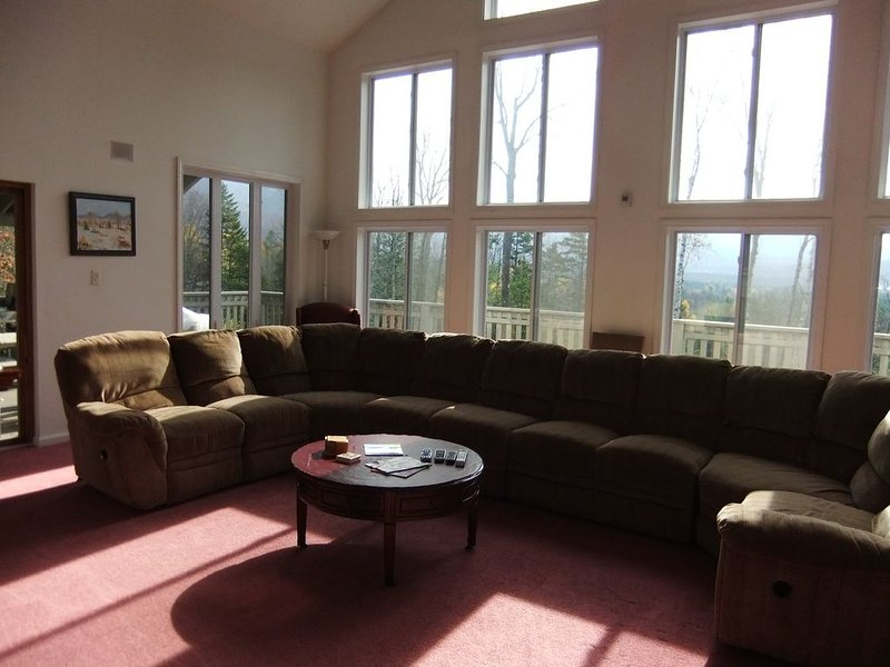 Living room with gorgeous mountain views and plenty of seating space