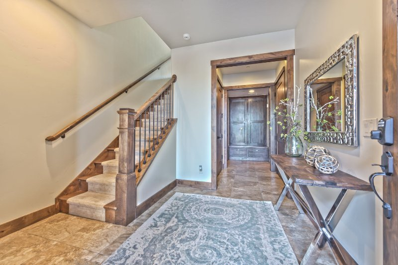 Front Entryway and Entry from the Garage, Laundry and Mud Room, and Stairway to the Main Level Great Room