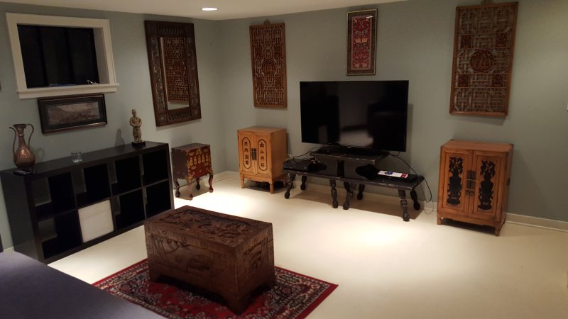 Large TV (55') with cable, Netflix, Hulu and Amazon Prime in tastefully decorated living space.